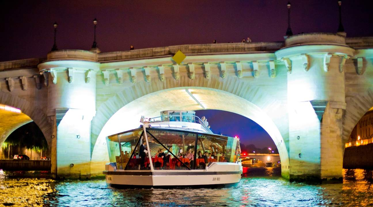 a cruise boat on the Seine River at night